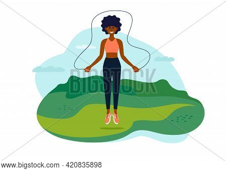 Outdoor Physical Activity. Young African American Woman Jumping With Jump Ropes. Black Female Traini