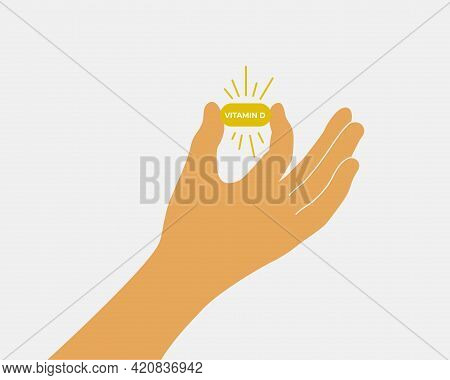 Human Hand Holding Vitamin D Pill. Healthcare, Cure, Treatment Concept. Female Or Male Fingers Show