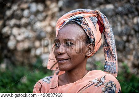 Black African senior beautiful woman with scarf outdoors