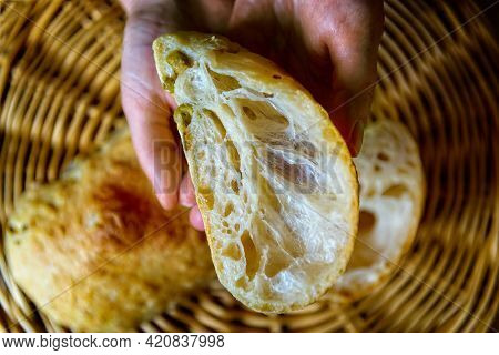 Example of bread made from flour rich in gluten. Visible gluten fibers. Tradiional Italian ciabatta bread, homemade.