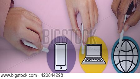 Composition of people touching digital online icons over pink background. global networks and digital interface concept digitally generated image.