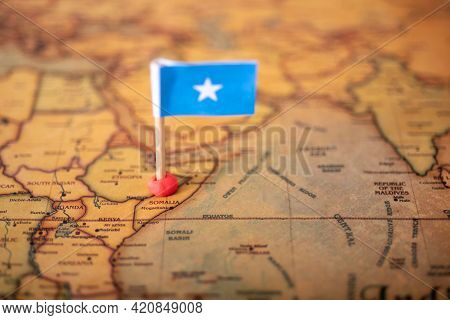 The Flag Of Somalia On The World Map.