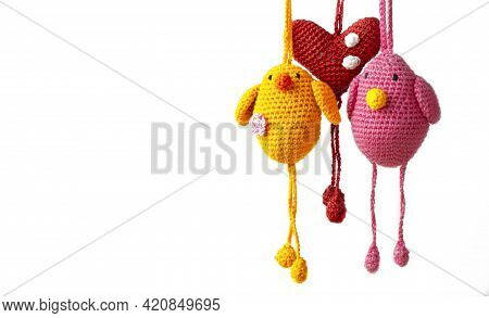 Two Amigurumi Birds Flying Together With A Heart In The Middle. Concept Of Tender Friendship And Lov
