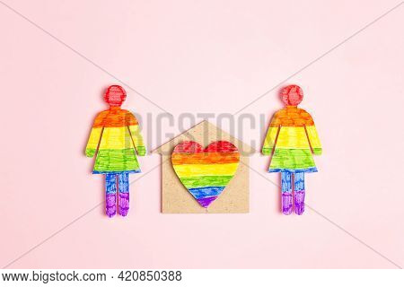 Lesbian Couple Figures With Home Symbol And Rainbow Heart On Pink Background. Homosexual Family Conc
