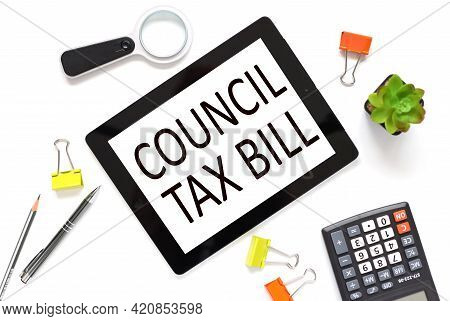 Council Tax Bill. The Text Is Written On A White Tablet Screen. The Tablet Lies On A White Workspace