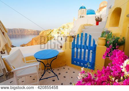 Street Of Oia, Traditional Greek Village Of Santorini With Caldera View With Flowers, Greece