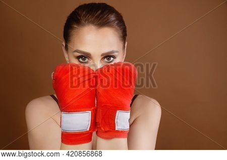 Attractive Young Caucasian Woman, Covering Her Face With Boxing Bandages Wrapped Around Her Hands, L