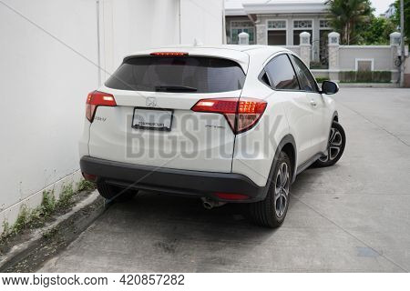 Nakorn Pathom Province, Thailand - 28 October 2020, The White Honda Hrv Car Parks Beside The Wall Of