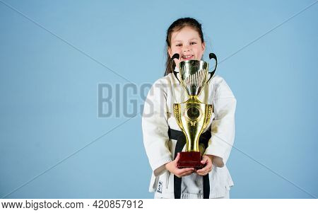 Knockout. Energy And Activity For Kids. Winner Little Girl In Gi Sportswear. Small Girl With Champio