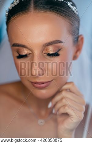 Close Up Of Elegant Bride With Makeup And Hairstyle