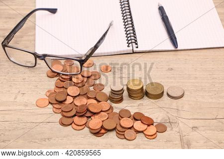 Pre-installation Of Money Saving Concept. Money And A Financial Income Chart Are On The Desk In The