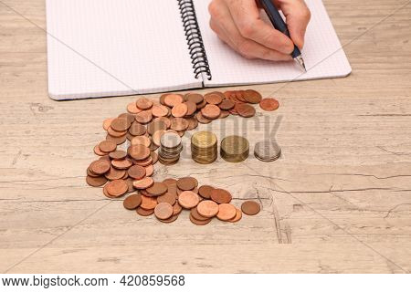Saving Money Concept Preset. A Man's Hand Is Counting Money For A Report In The Office.