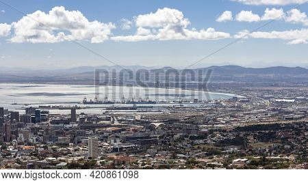 Panorama Of The Coast And The Seaport In The Bay In Cape Town. Berthing Facilities With Pier, Cranes