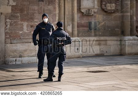 Vienna, Austria - February 02, 2021: Two Austrian Policemen Standing In Front Of Church