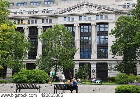 London, Uk - July 9, 2016: People Enjoy Summer In Bloomsbury Square Garden In London. The Building I
