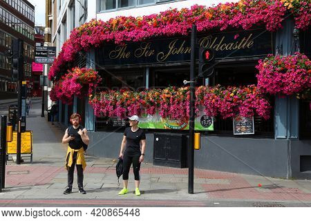 London, Uk - July 9, 2016: People Walk By The Sir John Oldcastle Typical Pub In Farringdon, London.