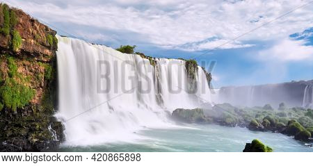 Iguazu Waterfalls In Argentina, View From Devils Mouth. Panoramic View Of Many Majestic Powerful Wat