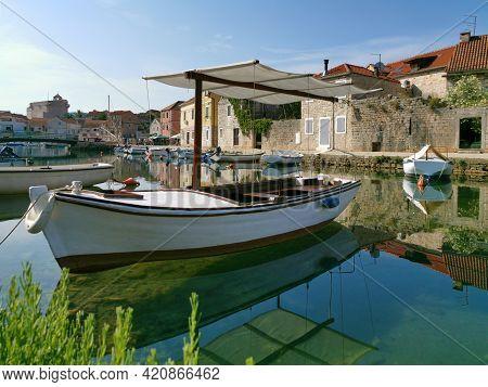 Fisherman Boat On The Canal In The Harbor Of Vrboska Village, Hvar Island, Croatia