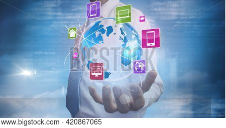 Businessman holding digital hearth and social network around the world. against blue digital background. digitally generated image