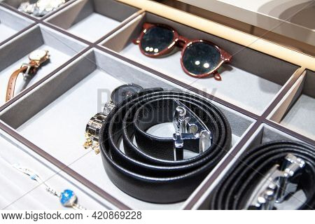Leather Strap, Sun Glasses And Other Accessories In The Storage Box