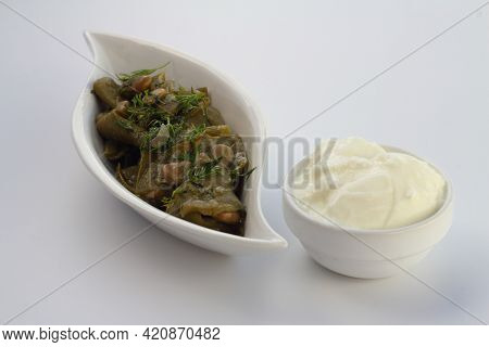 Broad Bean And Dill In The White Plate With White Background. With Yoghurt