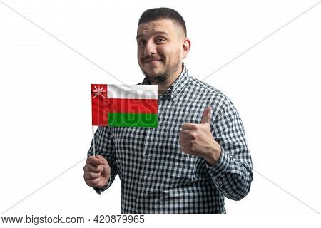 White Guy Holding A Flag Of Oman And Shows The Class By Hand Isolated On A White Background. Like Fo