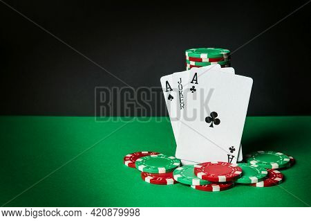 Poker Cards With Three Of A Kind Or Set Combination. Close-up Of Playing Cards And Chips In Poker Cl