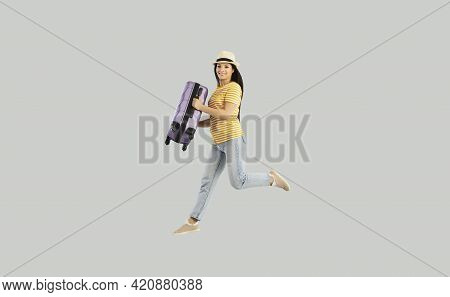 Joyful Young Caucasian Woman Jumping Holding Suitcase Luggage Studio Shot