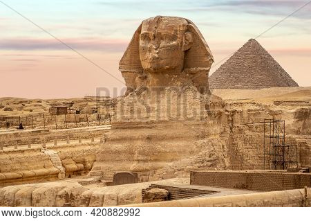 General View Of Pyramids With Sphinx. The Sphinx In Giza Pyramid Complex At Sunset. Incredible View
