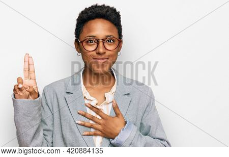 Young african american woman wearing business clothes smiling swearing with hand on chest and fingers up, making a loyalty promise oath