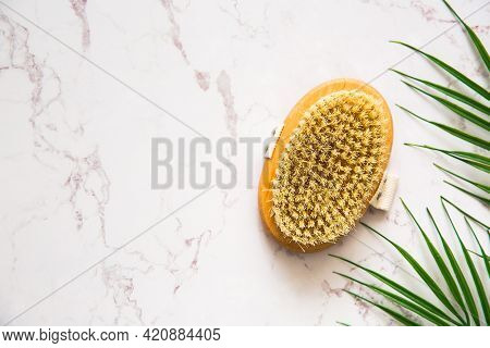 Brush For Dry Anti Cellulite Massage On Marble Background. Body Care Concept. Copy Space.