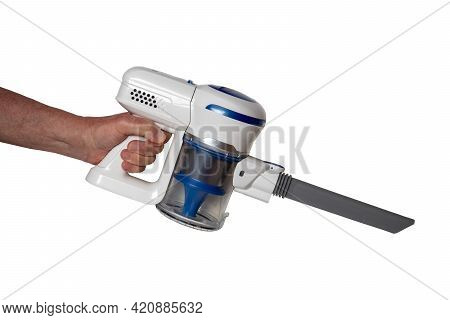 Vacuum Cleaner Isolated. The Male Hand Holds Hold A Modern Cordless Battery-powered Vacuum Cleaner I