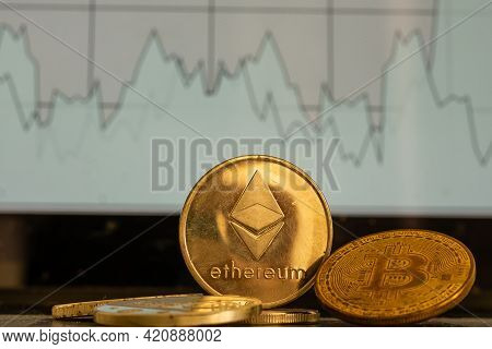 Ethereum Eth Cryptocurrency Silver Ethereum Coin On The Background Of The Chart