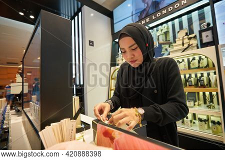 SINGAPORE - CIRCA JANUARY, 2020: woman pack up the goods in Sephora store at Nge Ann City shopping center.