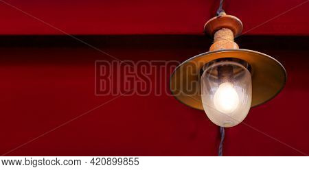 Iron Retro Lighting Lantern With A Glass Transparent Shade With An Electric Incandescent Lamp, A Dec