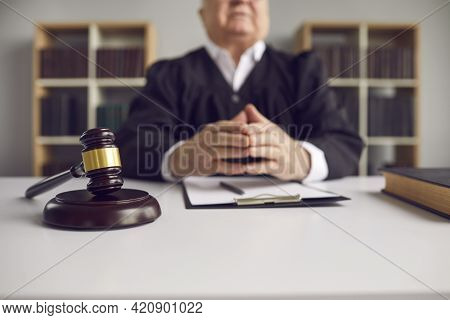 Close Up Of A Wooden Gavel Lying On A Sound Block On A Judges Desk In The Courtroom.