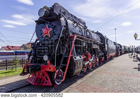 Black Retro Steam Locomotive With A Red Star. Museum Complex Of The History Of The Railway. Vintage