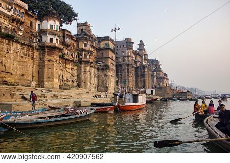 Varanasi, India - November 01, 2016: People, Pilgrims And Tourists On Wooden Boat Sightseeing In Gan