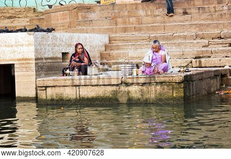 Varanasi, India - November 01, 2016: Two Indian Women In Saree Doing Prayer And Ritual In The Ganges