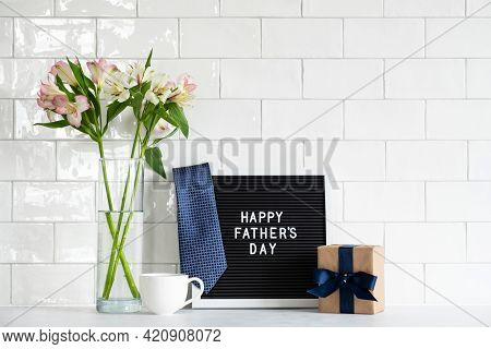 Happy Fathers Day Concept. Letterboard With Text Happy Father's Day, Necktie, Gift Box, Cup Of Coffe
