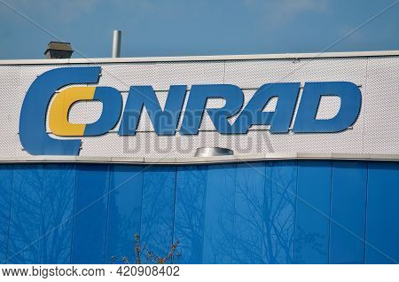 Dietlikon, Zurich, Switzerland - 16th April 2021 : Conrad Electronics Store Sign Hanging On A Buildi