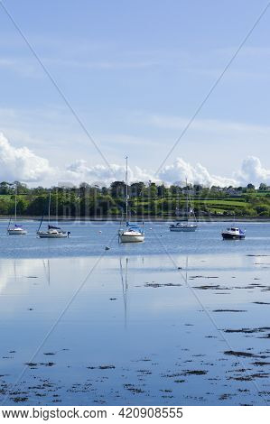 Anglesey, Red Wharf Bay. Traditional Fishing Boat Moored On In The Bay At Low Tide. Beautiful Seasca