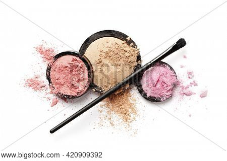 Colorful palette of eyeshadows and blushers. Professional makeup brushes and tools isolated on white background