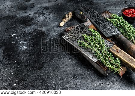 Chopping Board And Meat Cleaver With Knife. Black Background. Top View. Copy Space