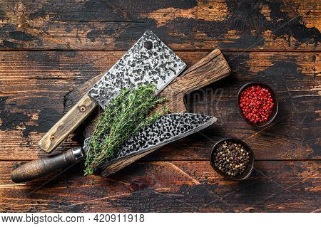 Old Butcher Meat Cleaver And Knife. Dark Wooden Background. Top View