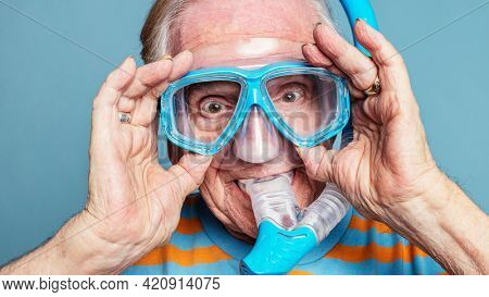 Funny senior man wearing snorkeling goggles