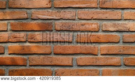 Red Brick Wall. Arranged Neatly With Cement. Can Be Used As Background Design Material