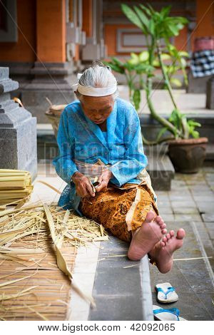 Balinese Old Women Make Baskets For Offerings
