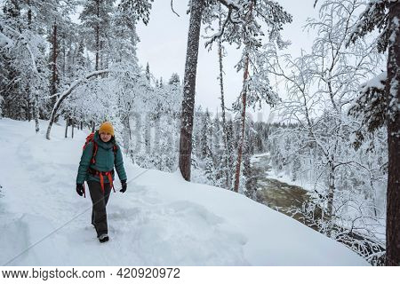 Woman trekking through a snow covered Lapland, Finland