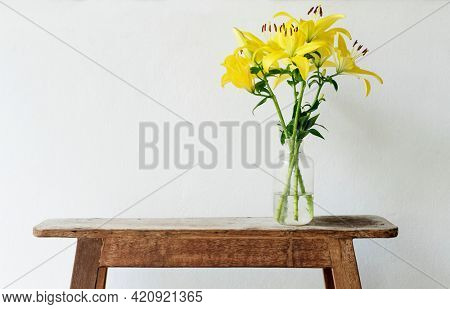 Asiatic lily in a vase by the wall